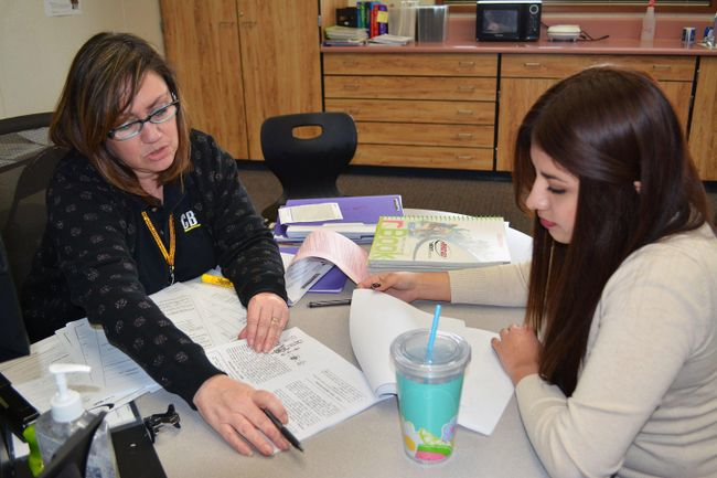 Teacher discussing work with a student
